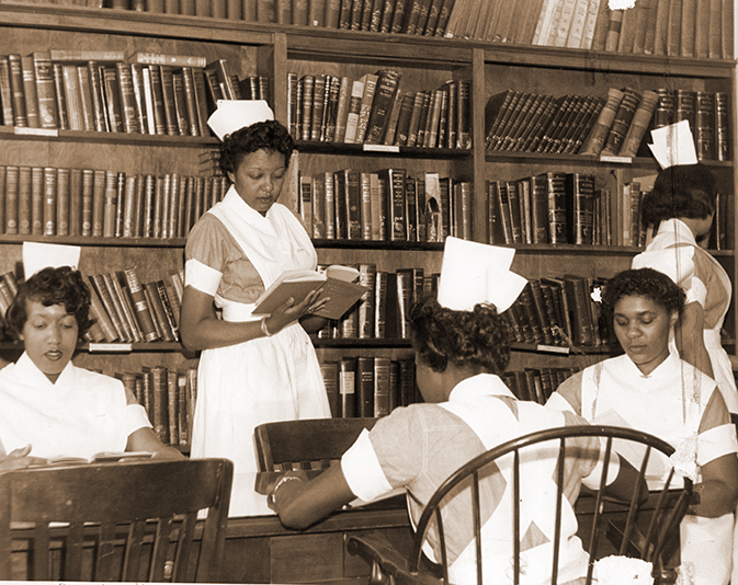 Mercy Douglass School of Nursing Class of 1959 in library. Image Courtesy of the Barbara Bates Center for the Study of the History of Nursing